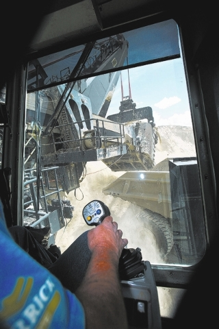We Nye operates a P&H electric mining shovel while he loads a Liebherr T282B truck at the Barrick Gold Corp. Cortez mine, located about 70 miles southwest of Elko, Nevada Tuesday, Aug. 7, 2012. Th ...