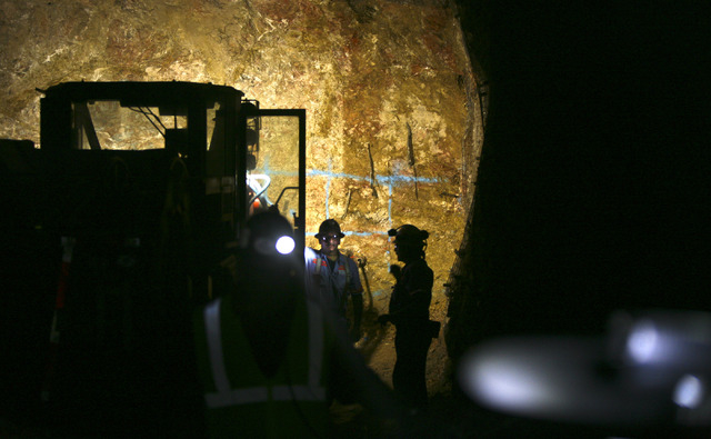 Miners stand near an underground drilling operations at Cortez Hills Wednesday, Aug. 8, 2012, located about 70 miles southwest of Elko, Nevada. Miners operating jumbo drills bore 50 to 60 holes in ...