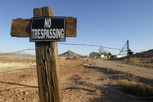 A barbed wire fence posted with a no trespassing sign is shown on the outskirts of the one-time boomtown of Goldfield, Nevada on Sept. 11, 2009. Goldfield, which in the early 1900s was the largest ...