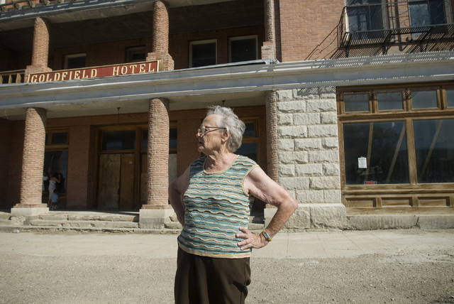 Goldfield, Nevada resident Virginia Ridgway stands outside the boarded up Goldfield Hotel on Sept. 11, 2009. Goldfield, which in the early 1900s was the largest town in Nevada with a population of ...