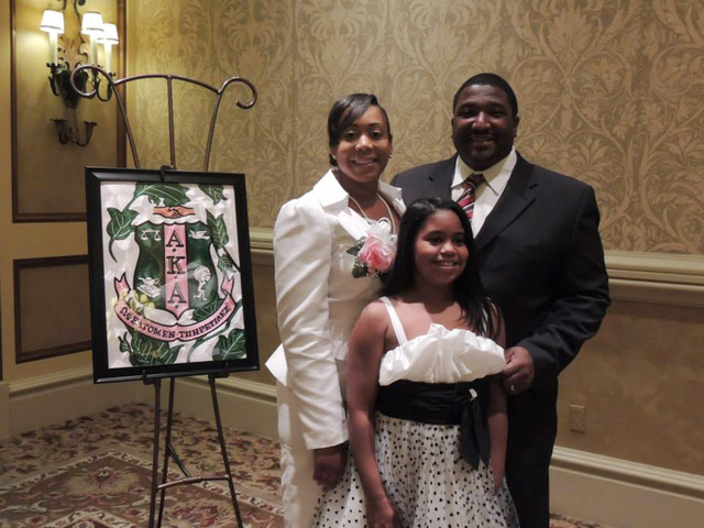 Dr. Lisa Morris Hibbler, photographed with her family,  is the first president of the newly chartered Psi Upsilon Omega Chapter of Alpha Kappa Alpha Sorority, Inc. The Henderson-based chapter is t ...