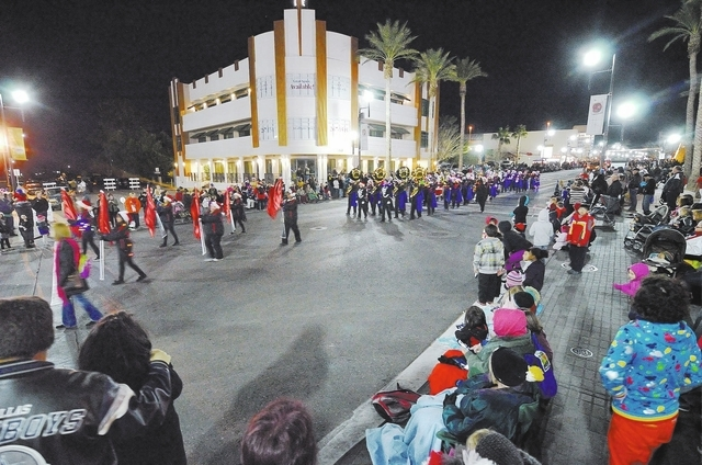 Part of the annual Christmas parade passes by the crowd during WinterFest in the Water Street District in Henderson on Saturday, Dec. 14, 2013. (Bill Hughes/Las Vegas Review-Journal)
