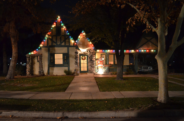 Holiday lights and decorations brighten the Goumond House, one of homes along Heritage Street, at the Clark County Museum, 1830 S. Boulder Highway. The homes were decorated as part of the museum's ...