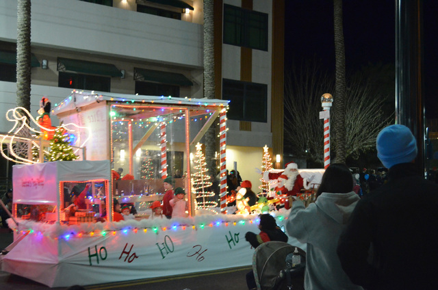 A Santa's workshop float drives down Water Street during the Henderson WinterFest nighttime parade, Dec. 14, 2013. (Ginger Meurer/Las Vegas Review-Journal)
