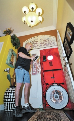 Bill Douglas, a project manager with Today's Energy Store, prepares to do a blower door test while doing a home energy assessment at a house near the intersection of Viento Del Montagna Avenue Cab ...