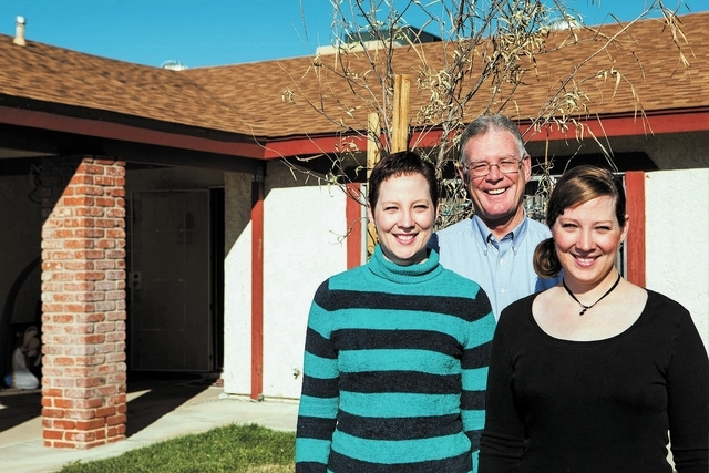 Henderson Mayor Andy Hafen, center, poses with daughters Mandy, left, and Amy, at their home near East Horizon Drive and Greenway Road in Henderson on Saturday, Dec. 14, 2013. The home, which Mand ...