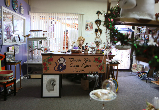 Linda Martin, co-owner of Purple Monkey, works at her computer at Purple Monkey craft consignment and gift shop Thursday, Dec. 12, 2013, in Henderson. Purple Monkey, which is located at 11 S. Wate ...