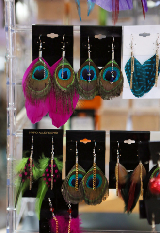 A selection of earrings made by Don Floresta are marked for sale at Purple Monkey craft consignment and gift shop Thursday, Dec. 12, 2013, in Henderson. Purple Monkey, which is located at 11 S. Wa ...
