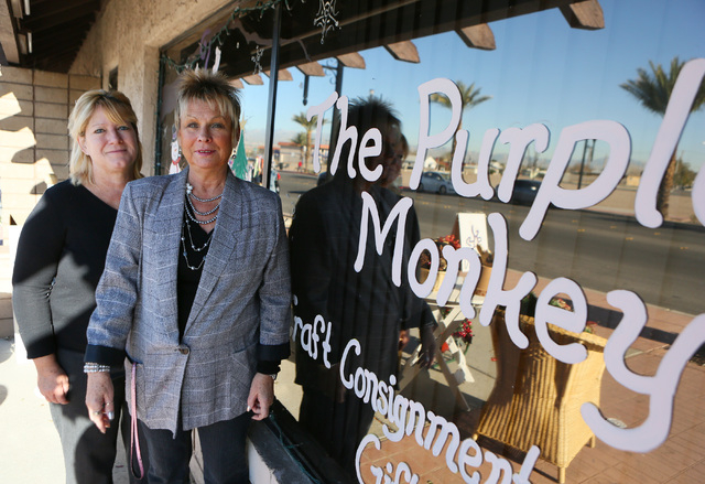 Shop owners Linda Martin, left, and Josi Dautel (cq) stand outside Purple Monkey craft consignment and gift shop Thursday, Dec. 12, 2013, in Henderson. Purple Monkey, which is located at 11 S. Wat ...