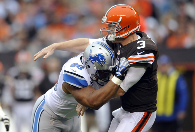 Lions defensive tackle Ndamukong Suh hits Browns quarterback Brandon Weeden in Detroit's 31-17 win on Oct. 13. An Associated Press review found an average of .962 penalties per game through the  ...