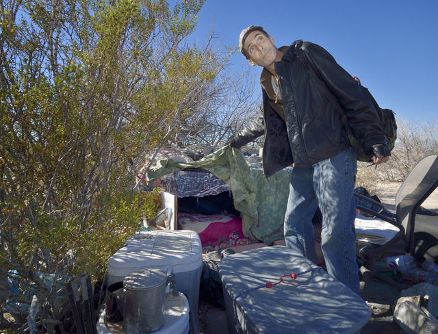 Homeless Marine veteran Michael Coughlin shows his living quarters at a homeless encampment near Lake Mead Boulevard and North Simmons Street in Las Vegas Friday, Dec. 13, 2013. Coughlin, who's a  ...