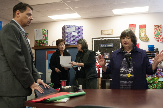 Pat Skorkowsky, left, Clark County School District superintendent, listens to Susan Goldman, director of Title 1 Homeless Outreach Program For Education, talk about the collected gifts going to st ...