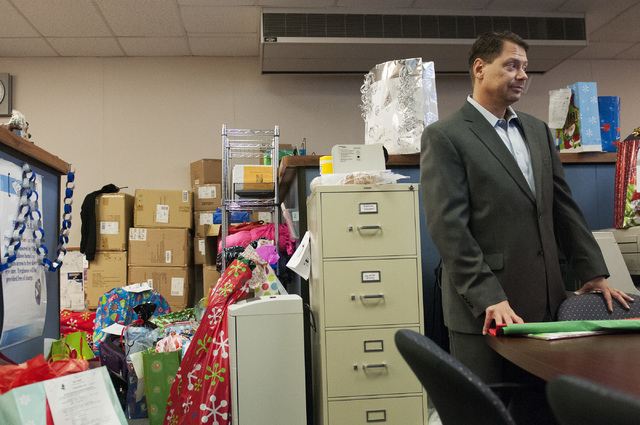Pat Skorkowsky, Clark County School District superintendent, listens to Susan Goldman, director of Title 1 Homeless Outreach Program For Education, talk about the collected gifts going to students ...