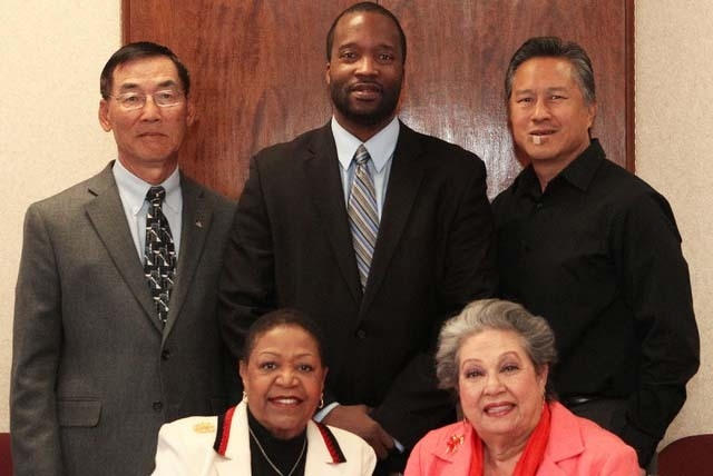 Past and present presidents for the minority Las Vegas Chambers of Commerce pose for a photo at the Review-Journal, Monday, Nov. 25, 2013. Pictured are: bottom row, left to right, Hannah Brown, pa ...