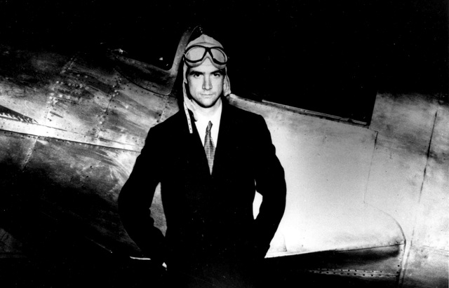 Businessman and aviator Howard Hughes poses beside his Hughes H-1 racing airplane. Hughes took part in the design of the aircraft, which he fles to set the world land speed record of 352 mph in 19 ...