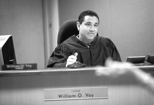 Judge William O. Voy listens to counsel speak in sexually exploited youth court in Las Vegas on Apr. 24, 2013. (Jessica Ebelhar/Las Vegas Review-Journal)