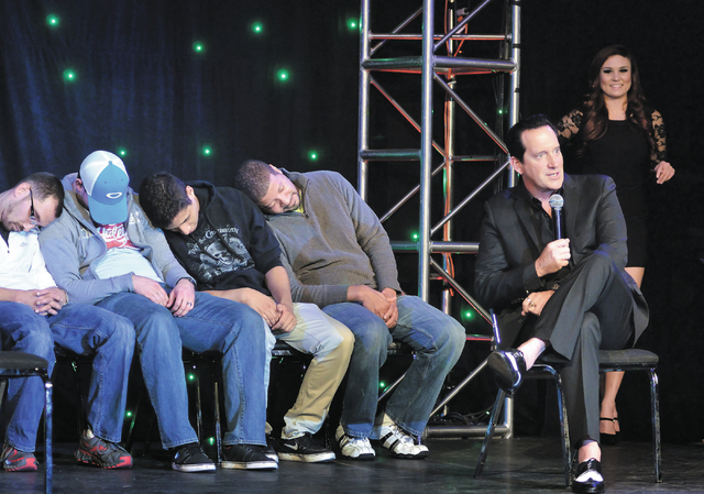 "Hypnotist Anthony Cools talks with the audience after putting audience volunteers to sleep during the ""Anthony Cools Experience"" in the Paris hotel-casino at 3655 Las Vegas Blvd., South, ..."
