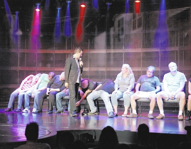 "Comic hypnotist Marc Savard talks with volunteer guests before he puts the to ""sleep"" on-stage, Thursday, Nov. 21, 2013 at V Theater in Miracle Mile Shops at Planet Hollywood Las Veg ..."