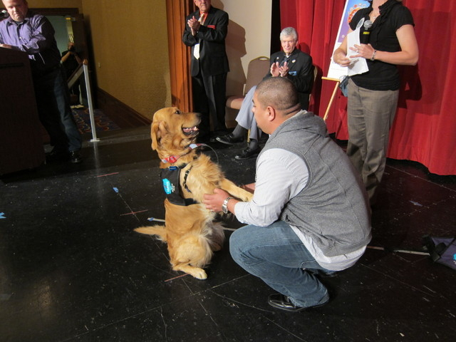Tony Ray Silva and Freedom are shown at the passing of the leash ceremony Dec. 10. (Special to View)