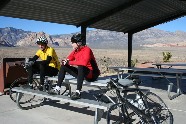 David Hock, left, and John Burke, both of Las Vegas, take a break at the rest area during a bike ride at Red Rock Canyon National Conservation Area, Dec. 22. (Lynn Benson/View)