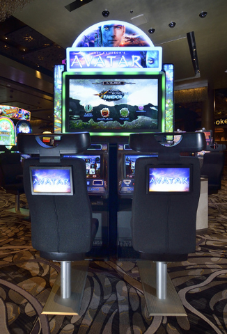 """""""Avatar"""" slot machines produced by IGT are shown at the Aria hotel-casino at 3730 Las Vegas Blvd., South, in Las Vegas Wednesday, Dec. 18, 2013. (Bill Hughes/Las Vegas Review-Journal)"""