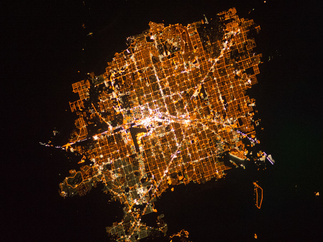 A view of the Las Vegas metropolitan area, photographed at night, seen from on board the International Space Station. The image in this article has been cropped and enhanced to improve contrast. L ...