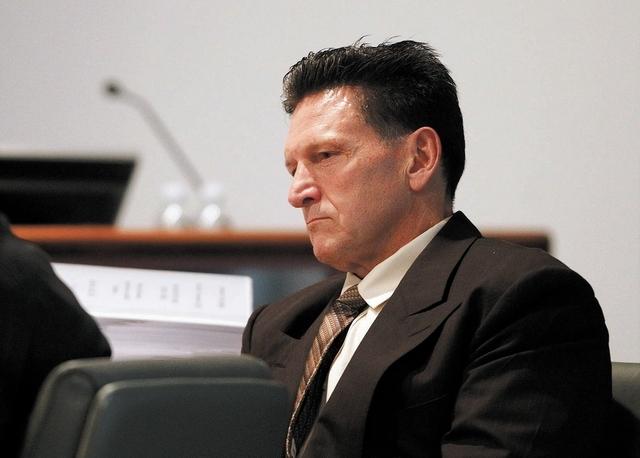 Family Court Judge Steven Jones attends his disciplinary hearing in Las Vegas Wednesday, Dec. 4, 2013. (John Locher/Las Vegas Review-Journal)
