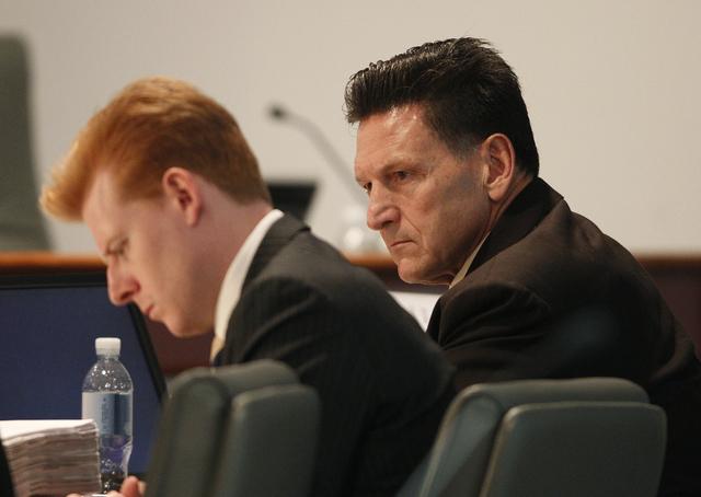 Family Court Judge Steven Jones, right, attends his disciplinary hearing in Las Vegas Wednesday, Dec. 4, 2013. (John Locher/Las Vegas Review-Journal)