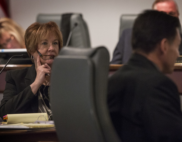 Special Counsel Kathleen Paustian, left, listens while suspended Family Court Judge Steven Jones  testifies during a Nevada Commission on Judicial Discipline hearing at Las Vegas Convention Center ...