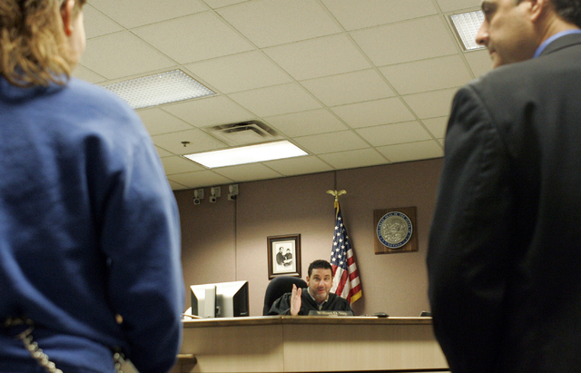 CRAIG L. MORAN/LAS VEGAS REVIEW-JOURNAL Newsu2014Left, A juvenile prostitute faces judge William Voy during his morning court session held at the Family Court Building located at 605 South Pecos  ...