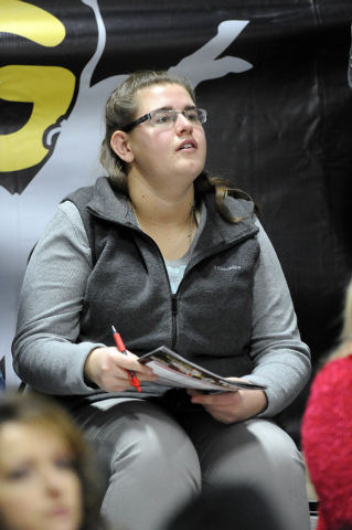 Stock contractor Jayci Mead, 21, of Thermopolis, Wyo., watches her bull named JJ's Dream buck to a score of 81.8 during the Exclusive Genetics Million Dollar Bucking Bull Championship at Mandalay  ...