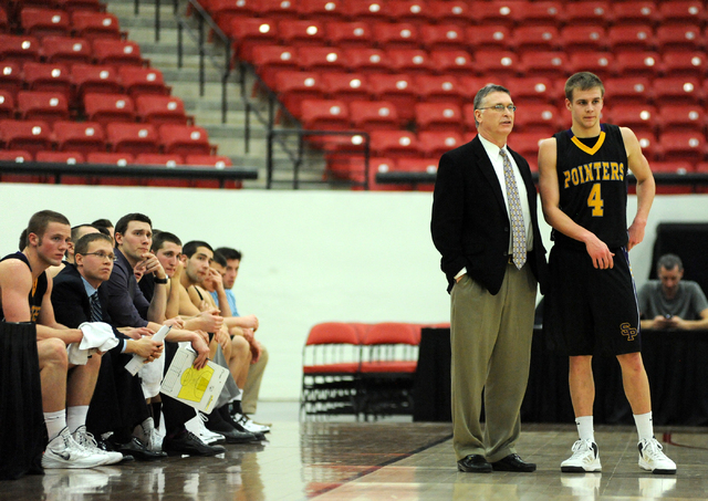 University of Wisconsin Stevens Point head coach, Bob Semling, center, talks to Tyler Tillema (4), right, during their game played against Whitworth University at the D3hoops.com Classic at the So ...