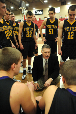 University of Wisconsin Stevens Point head coach, Bob Semling, center in the suit and tie, coaches his team during their game played against Whitworth University at the D3hoops.com Classic at the  ...