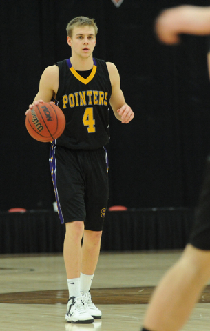 University of Wisconsin Stevens Point basketball player Tyler Tillema (4) dribbles the basketball as he plays against Whitworth University during the D3hoops.com Classic at the South Point hotel-c ...