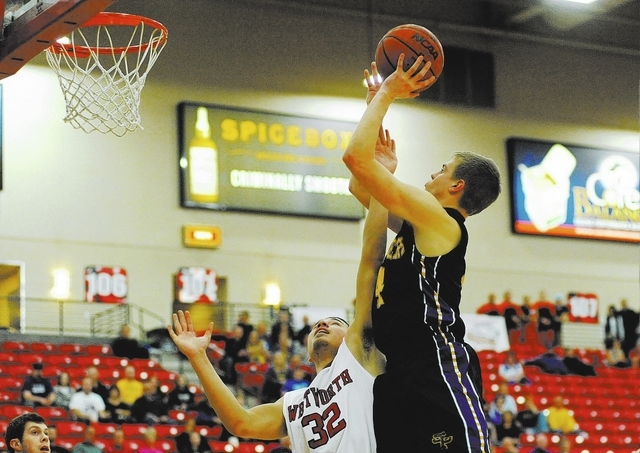 University of Wisconsin Stevens Point basketball player Tyler Tillema (4), right, shoots the basketball against George Valle (32) of Whitworth University during the D3hoops.com Classic at the Sout ...