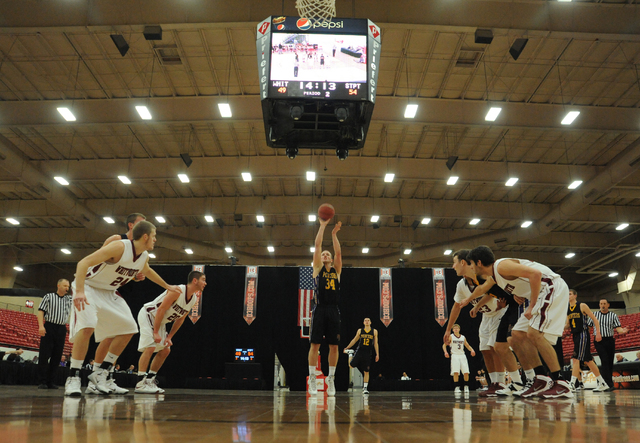 University of Wisconsin Stevens Point basketball player Trevor Hass (23), center, shoots a free throw against Whitworth University during the D3hoops.com Classic at the South Point hotel-casino in ...