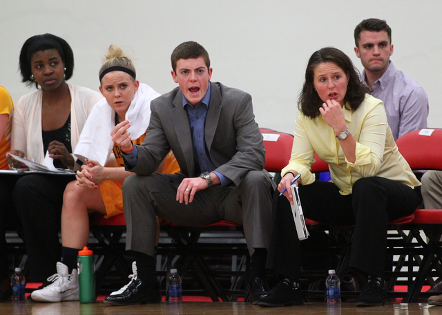 Marquette assistant coach Tyler Summitt, son of NCAA women's basketball coaching legend Pat Summitt, shouts to players as the Golden Eagles take on Tennessee Tech at the South Point Arena in Las V ...