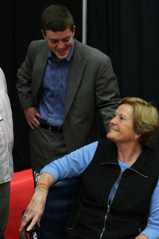 Marquette assistant coach Tyler Summitt, with his mom, NCAA women's basketball coaching legend Pat Summitt, talk after the Golden Eagles defeated Tennessee Tech at the South Point Arena in Las Veg ...