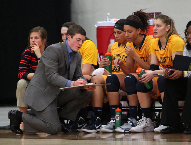 Marquette assistant coach Tyler Summitt, son of NCAA women's basketball coaching legend Pat Summitt, talks with players as the Golden Eagles take on Tennessee Tech at the South Point Arena in Las  ...