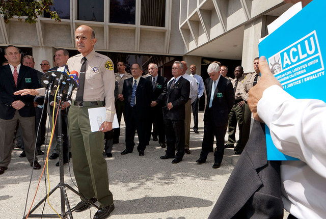 Los Angeles County Sheriff Lee Baca speaks Sept. 28 outside sheriff's headquarters in Los Angeles. At least seven current and former Los Angeles County sheriff's deputies were arrested Monday by t ...