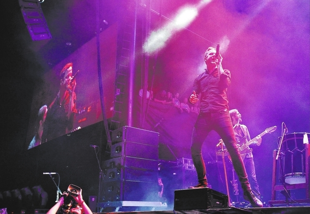 """Dan Reynolds of Imagine Dragons performs during the Life is Beautiful festival in Las Vegas on Oct. 26. Billboard magazine has named the group """"Top Rock Artist of 2013."""" (John Locher/Las Vegas ..."""