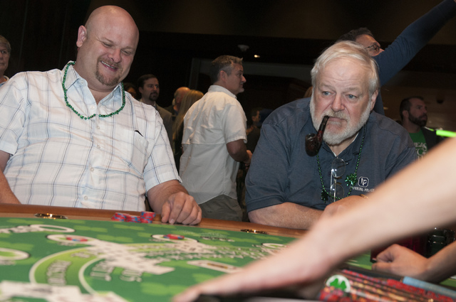 Trevor Smith, left, and Roger McCreight play a game of blackjack at O'Sheas casino in Las Vegas during their soft opening event on Friday, Dec. 27, 2013. (Erik Verduzco/Las Vegas Review-Journal)