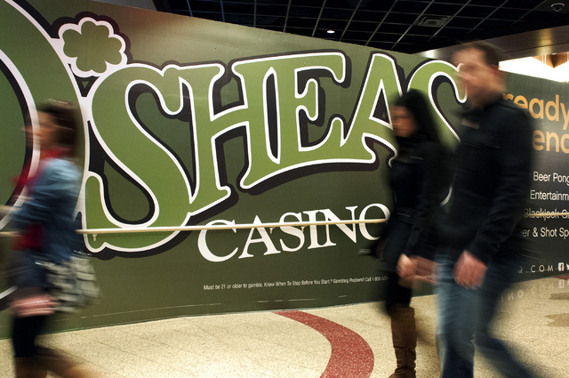 Visitors walk past an O'Sheas casino sign at The Linq in Las Vegas on Friday, Dec. 27, 2013. The Linq hosted a soft opening event for several of their businesses. (Erik Verduzco/Las Vegas Review-J ...