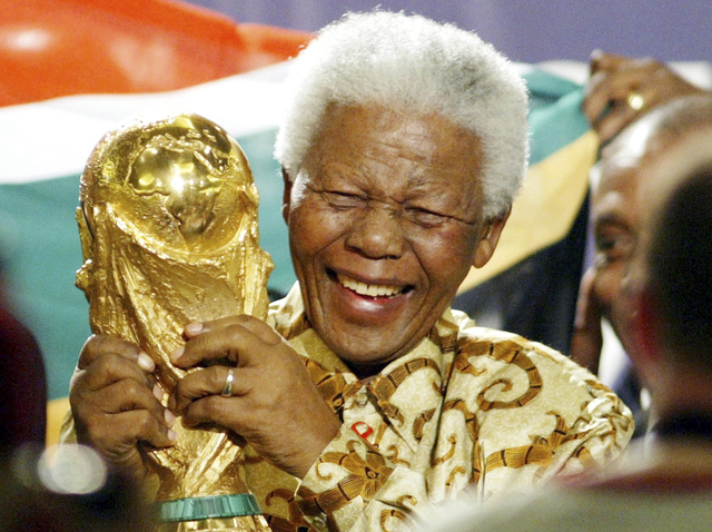 Former South African President Nelson Mandela lifts the World Cup trophy in Zurich, Switzerland, after FIFA's executive committee announced that South Africa would host the 2010 FIFA World Cup soc ...