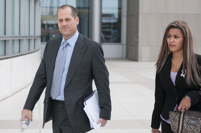 Monica Contreras, right, arrives at the Lloyd George Federal Courthouse in Las Vegas with her attorney, Ross Goodman, Tuesday, Dec. 3, 2013. Contreras is suing Clark County over allegations of bei ...