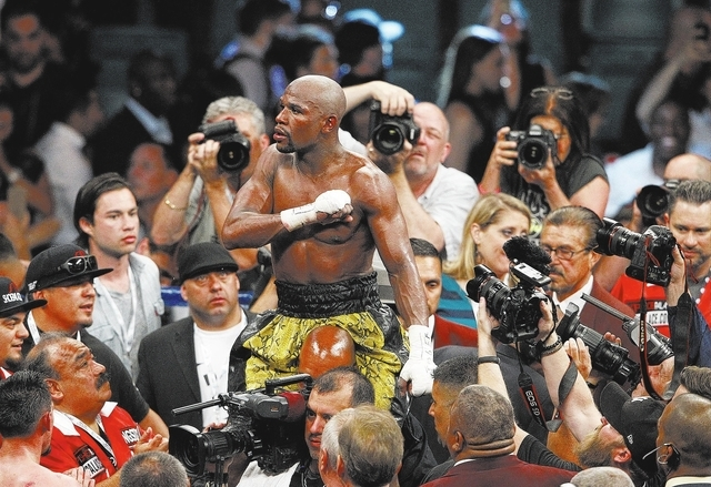 Floyd Mayweather Jr. celebrates after winning a unanimous decision over Robert Guerrero to keep his WBC welterweight title on May 4 at the MGM Grand Garden. This fight and Mayweather's clash wit ...