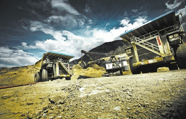 P&H electric mining shovel loads a Liebherr T282B trucks at the Barrick Gold Corp.Cortez mine, located about 70 miles southwest of Elko, Nevada Tuesday, Aug. 7, 2012. Barrick has 24 of the 400-ton ...