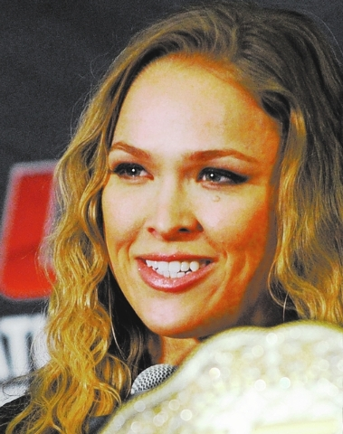 MMA fighter Ronda Rousey attends the UFC168 news conference at the MGM hotel-casino on Thursday, Dec. 26, 2013. Rousey will defend her bantamweight title against Miesha Tate during on Saturday's b ...