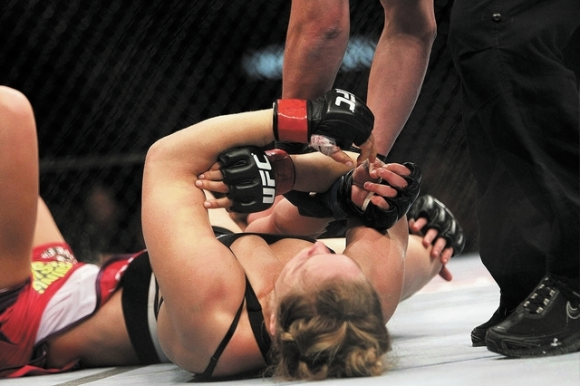 The ref stops the fight as Ronda Rousey submits Miesha Tate during UFC 168 at the MGM Grand Garden Arena in Las Vegas on Friday, Dec. 28, 2013. (Jason Bean/Las Vegas Review-Journal)
