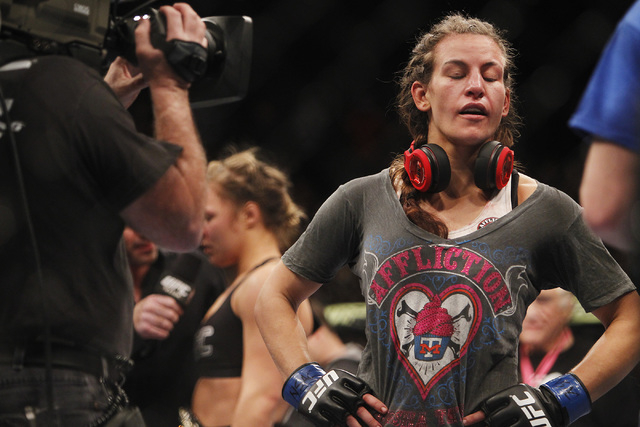 Miesha Tate accepts her defeat to Ronda Rousey during UFC 168 at the MGM Grand Garden Arena in Las Vegas on Friday, Dec. 28, 2013. (Jason Bean/Las Vegas Review-Journal)